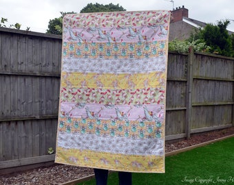 Modern baby girl blanket.  Pastel pink quilt fairy quilt, faerie cot quilt new baby gift princess quilt, riddles and rhymes, ditzy quilts UK