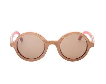 Super cool round multilayered wood sunglasses hand made in Italy, new and unworn