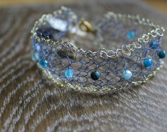 Blue and golden knit wire bracelet with blue agate semi precious  beads