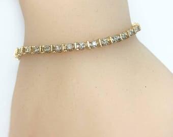 "6 3/4"" Diamond Tennis Bracelet / 0.76 Carats tw / 14k"