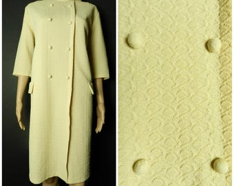 60s cream crimplene textured knitted a-line dress double breasted three quarter length sleeves funnel neckline U.K. 14  M