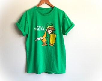 RARE 1989 Vintage Legend of Zelda T-Shirt Green Link Nintendo Fantasy Video Game Gamer Action Adventure Gaming Tee Women's Men's Size Large