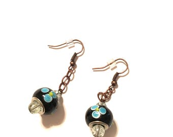Earrings. Lamp Beads.  Black with Blue Flowers. Oxidized copper Ear Wires and Brown Chain.