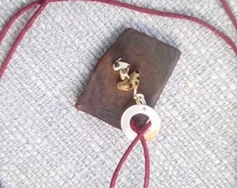 Necklace with ebony wood pendant with Dalmatian jasper beads