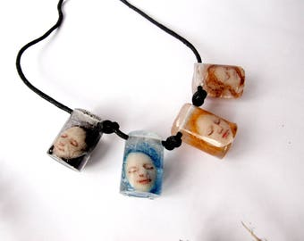 Quirky necklace doll heads Cool jewelry Unusual necklace Artisan necklace Body parts Weird terrarium Artistic necklace Frozen beauty