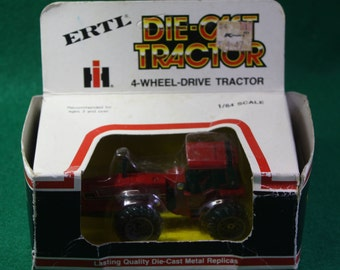 Vintage Ertl 1/64 scale diecast International Harvester red 4- wheel drive tractor-NOS