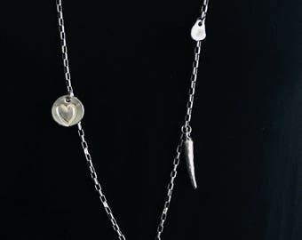 Long silver link necklace with peace pendent and multiple charms