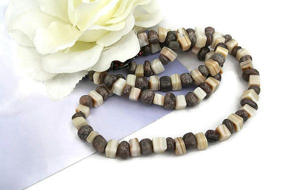 Dark gray stone and beige color shell bead necklace and bracelet by GunaDesign