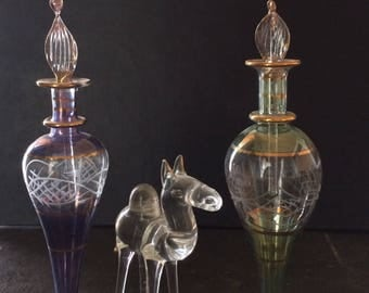 Persian-inspired hand decorated glass vials and crystal camel accent piece