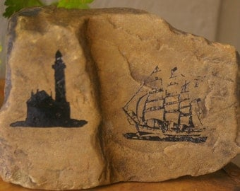 Clipper ship sailing by lighthouse engraving on this unique 3D Seaside rock