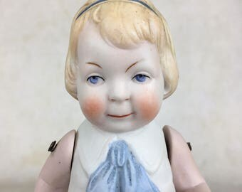 Antique all bisque miniature doll, molded costume, all bisque girl