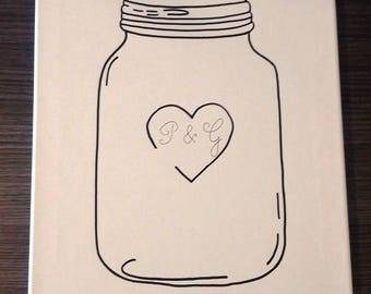"frame prints glass jar with ""our love reserve"" for 100-130 persons"