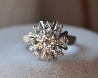 Bright and wintery snowflake-like vintage 18K white gold Diamond cluster ring
