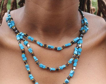 Handmade 3 Chain chrysocolla necklace with manganese beads.