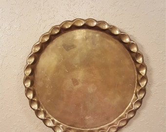 Large 14.5 inch heavy weight round brass vintage tray with scalloped edge and hanger on the back.  Brass wall platter.