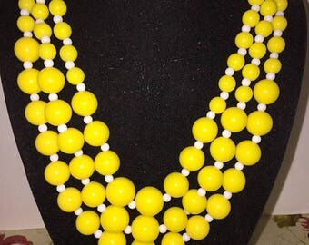 Vtg. Plastic bead necklace, yellow and white bead necklace. Rock a billy,3 strand necklace, vtg jewelry, costume jewelry