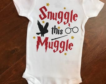 Snuggle this muggle, baby girls wizard baby bodysuit.