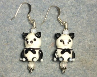 White and black tuxedo clad lampwork pig bead earrings adorned with milky white Czech glass beads.