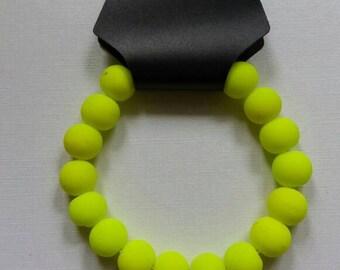 Neon yellow, blacklight reactive bracelet !