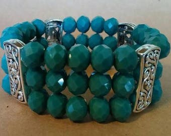 Green Glass and Silvertone Bracelet