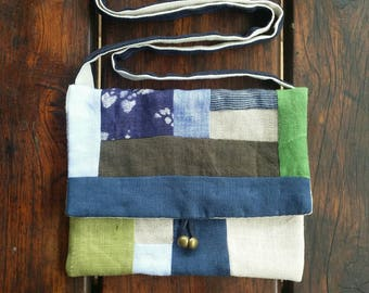 Cute little shoulder bag/purse made with all different pure linen fabrics patchworked together.