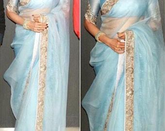 Powder blue saree with gold border