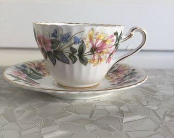 Paragon tea cup and saucer, blue yellow pink flowers