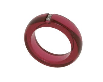 Paved diamonds and Red resin ring.