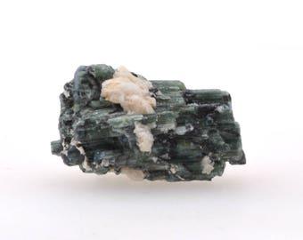 Small raw green tourmaline on black tourmaline, small verdelite