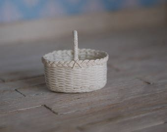 A miniature white basket