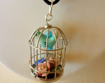 Fashion with a bird cage pendant necklace
