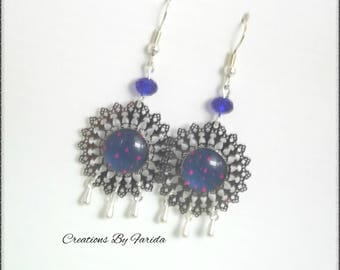 Earrings with filigree and blue cabochon harms stamp starry fushsia