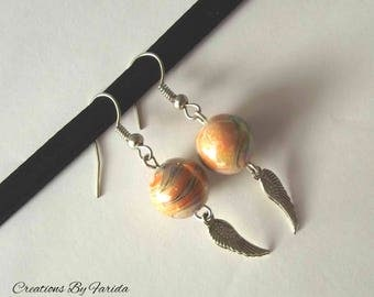 wave earrings with a wing pendant and Pearl orange effects