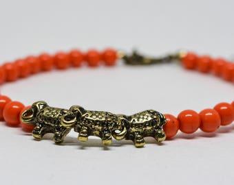 Lovely red tone beaded bracelet