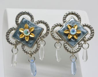 Charming silver tone earrings