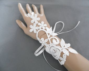 pair of mittens in light ivory floral lace bridal wedding ceremony