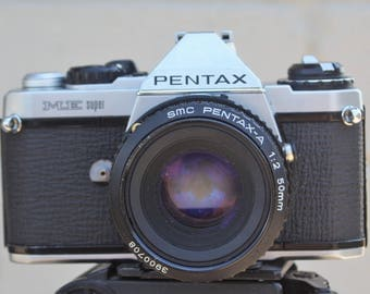 Pentax ME super with 50mm pentax A lens and 28mm  focal lens. And motor winder
