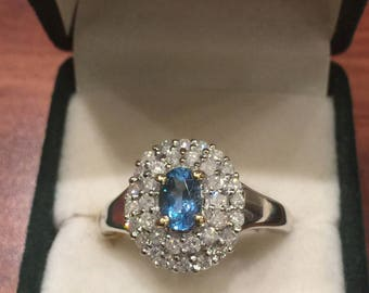 Cluster Ring set with 0.60ct Oval Blue Tourmaline and 34 surrounding diamonds