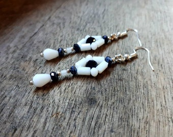 Beautiful crystal earrings in three different combinations black white  lavender or nature.