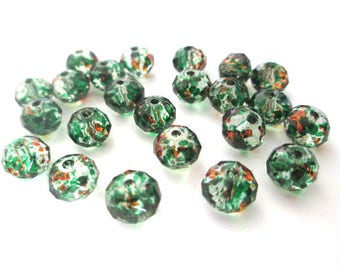 20 rondelle beads has mottled orange and green transparent faceted glass 6x8mm