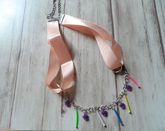 Ribbon and plastic necklace