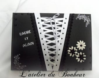 large guestbook Gothic black and white with its laced corset way