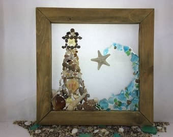 Ocean Wave & lighthouse framed beach glass art. 10 x 10 stained solid wood frame. Ready for hanging. Seascape design