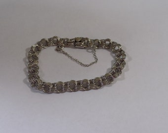 Beautiful sterling silver charm bracelet size 7 inches 15.3 grams