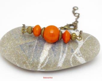 """Bracelet bronze """" Many """" en perles de céramique oranges"""