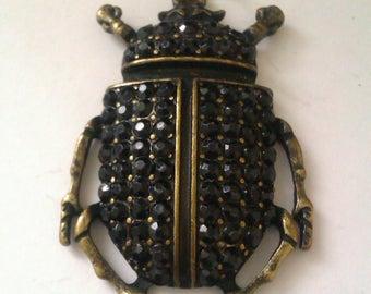 brass coloured metal scarab beetle pendant