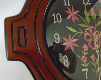mahogany coloured wood  wall clock with embroidered decorative face