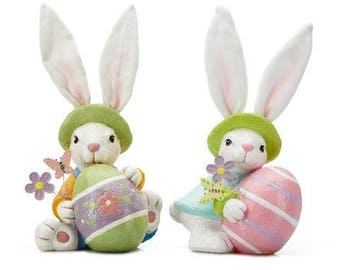 2 Easter Bunnies Figurines Holding Easter Eggs