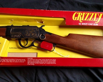 Rare vintage 1970'sEdison Toys  Supermatic Grizzly 13 shot Toy Cap gun New old stock in original package made in Italy Old West Cowboy gun