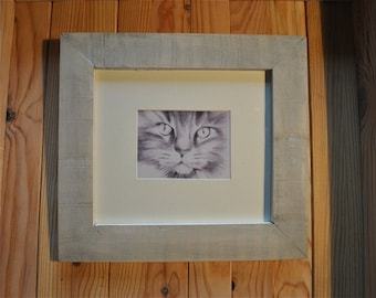 A bleached with his cat wooden frame.